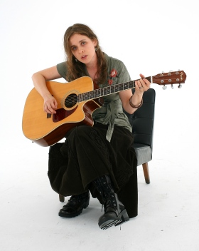 andreja seated with guitar